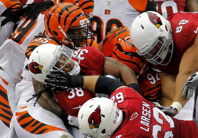 Arizona Cardinals running back Andre Ellington (38) is tackled by Cincinnati Bengals outside linebacker Vontaze Burfict (55) during the first half of an NFL preseason football game, Sunday, Aug. 24, 2014, in Glendale, Ariz.
