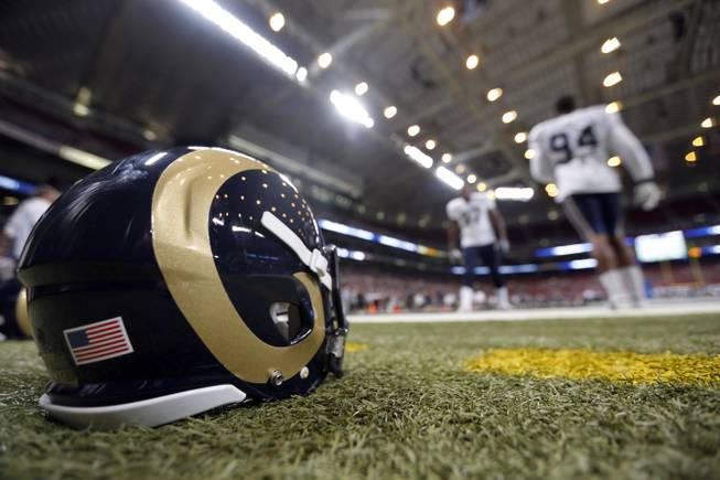 St. Louis Rams defensive end Robert Quinn, right, and Eugene Sims take part in a drill during NFL football training camp at Edward Jones Dome Saturday, Aug. 2, 2014, in St. Louis.