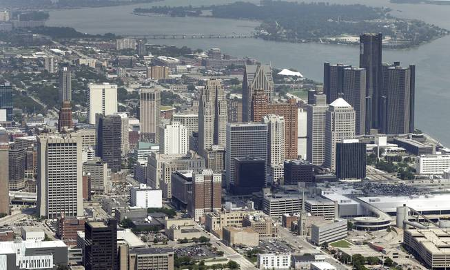 In this July 16, 2013 aerial file photo, the downtown of the city of Detroit is shown. Detroit Emergency Manager Kevyn Orr raised more than a few eyebrows a year ago when he took the city into bankruptcy and predicted it would be out by the time his term expired in fall 2014. Because it is by far the largest city to file for municipal bankruptcy and the issues were so complex many experts predicted it would take years to resolve. But the city will take a major step toward that goal with a trial in federal bankruptcy court that starts Tuesday, Sept 2, 2014.