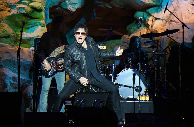 "This undated photo shows Jimi Jamison performing at Mohegan Sun Hotel and Casino in Uncasville, Conn. Jamison, who sang lead on Survivor hits such as ""Burning Heart"" and ""Is This Love,"" has died. He was 63."