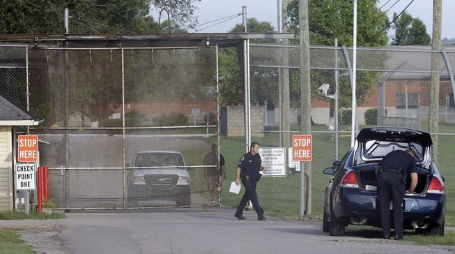 Police work in front of the Woodland Hills Youth Development Center Tuesday, Sept. 2, 2014, in Nashville, Tenn. Thirty-two teens escaped from a Nashville youth detention center by crawling through a weak spot in a fence late Monday, and more than half of them were still on the run Tuesday, a spokesman said.