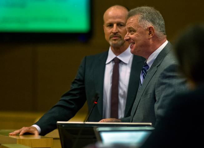 Dean House speaks while joined by Justin Findlay as they address the Las Vegas City Council during a presentation on the proposed downtown soccer stadium on Wednesday, September 3, 2014.