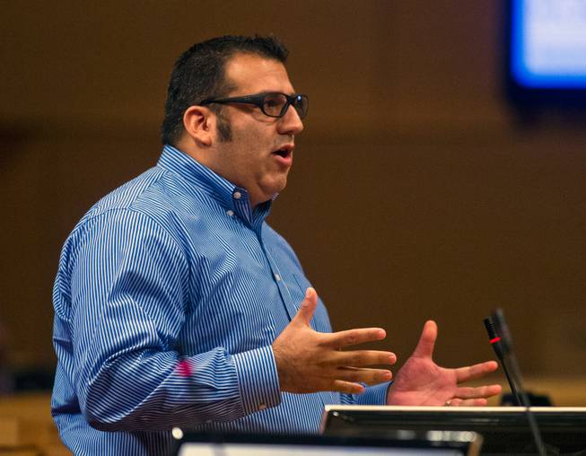 Public speaker Andres Ramirez addresses the Las Vegas City Council receives a presentation on the proposed downtown soccer stadium prior to their vote whether to approve financial terms of the deal on Wednesday, September 3, 2014.