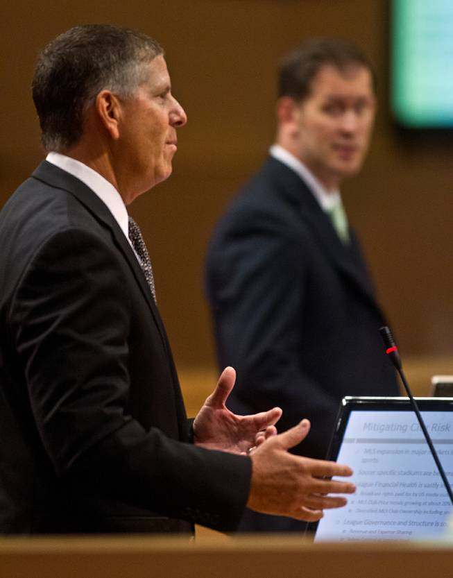 David Abrams speaks with Bill Arent nearby to the Las Vegas City Council on the proposed downtown soccer stadium before they vote whether to approve financial terms of the deal on Wednesday, September 3, 2014.