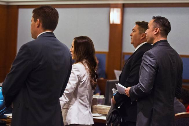 Lawyers stand and address the judge as Jon Koppenhaver appears briefly in court facing felony charges, including assault with a deadly weapon, lewdness, coercion and multiple counts of battery on Wednesday, September 3, 2014.  L.E. Baskow