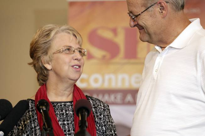 Nancy Writebol, who spent weeks in isolation after contracting the deadly Ebola virus in Liberia, looks to her husband, David, during a news conference Wednesday, Sept. 3, 2014 in Charlotte, N.C. This is the first time that the Charlotte woman, who was recently released from an Atlanta hospital, has spoken publicly about her experience. She and her husband, both missionaries, had been in Liberia for a year working in a clinic when she contracted the disease.