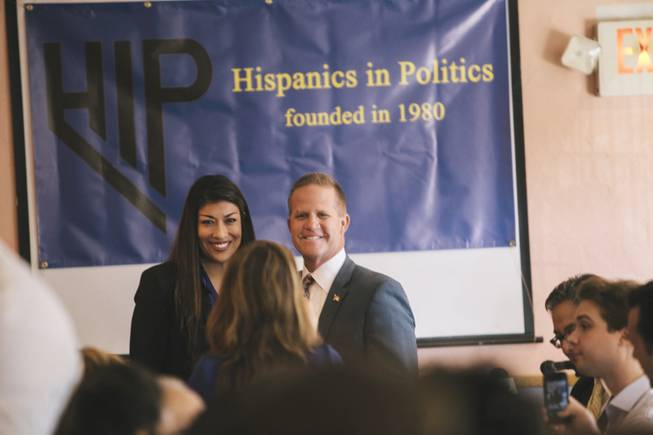 "Nevada lieutenant governor candidates Lucy Flores and Mark Hutchison pose at their first public debate, hosted by Hispanics in Politics, Wednesday, Sept. 3, 2014. They fielded questions for a half-hour during an appearance on KRNV-TV's ""Nevada Newsmakers"" that was broadcast Tuesday, Sept. 30, 2014."