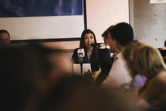 Nevada lieutenant governor candidate Lucy Flores speaks against opponent Mark Hutchison during their first public debate , hosted by Hispanics in Politics, Wednesday Sept. 3, 2014.
