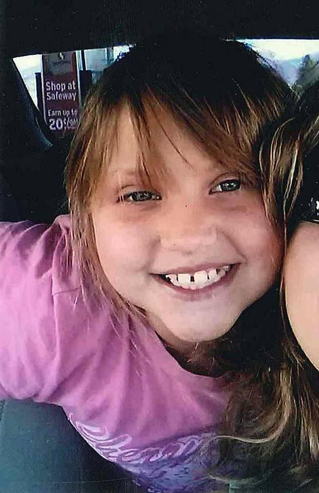 "This undated file photo provided by the Bullhead City, Ariz., Police Department shows Isabella ""Bella"" Grogan-Cannella, an 8-year-old Bullhead City girl who was reported missing on Sept. 2, 2014, and found dead a day later."