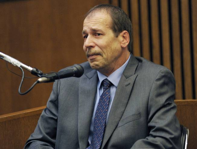 FILE - In this Aug. 4, 2014 file photo, Theodore Wafer, of Dearborn Heights, Mich., testifies in his own defense during his trial for the Nov. 2, 2013, killing of Renisha McBride in Detroit. Wafer was sentenced WednesdaySept. 3, 2014 to at least 17 years in prison for killing an unarmed woman who appeared on his porch before dawn.