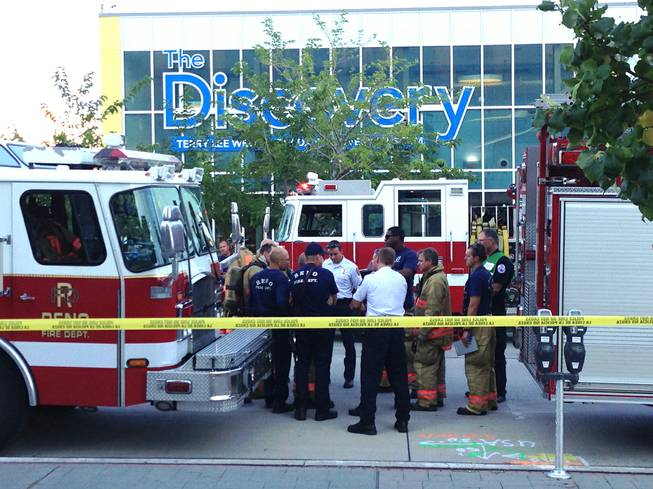 Firefighters confer outside the Nevada Discovery Museum in Reno, Wednesday, Sept. 3, 2014. A minor explosion during a science experiment at the museum burned several children and forced the evacuation of the museum.
