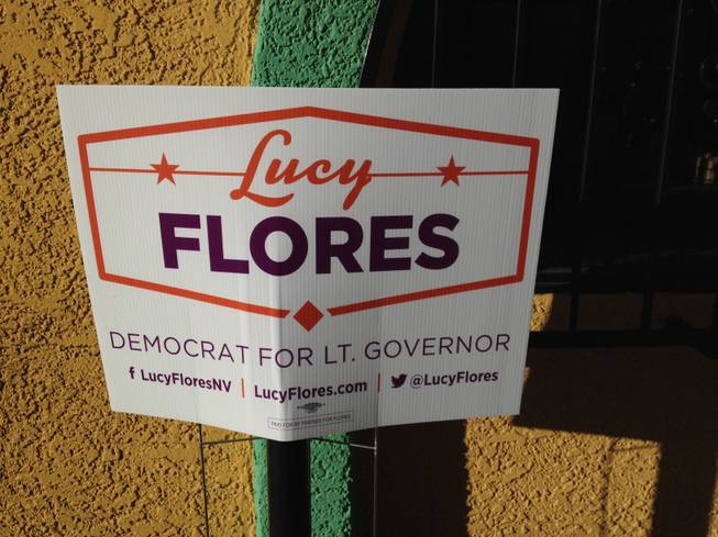 A promotional sign for Lt. Gov candidate Lucy Flores is pinned to the wall outside a Hispanics in Politics breakfast, where Flores and Republican Mark Hutchison are staging a debate Sept. 3, 2014.