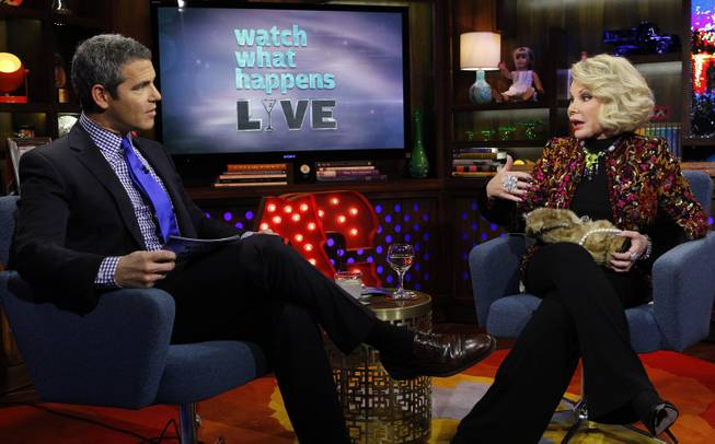 "COMMERCIAL IMAGE - In this photograph taken by AP Images for Bravo, Andy Cohen, left, talks with Joan Rivers on Bravo's ""Watch What Happens Live"" show on Thursday, Feb. 16, 2012, in New York."