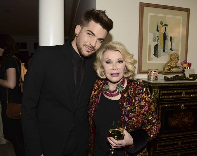 "Singer Adam Lambert, left, and comedian Joan Rivers at the ""Glamorous By George"" book launch hosted by Joan and Melissa Rivers on Monday, Jan. 13, 2014 in Los Angeles."