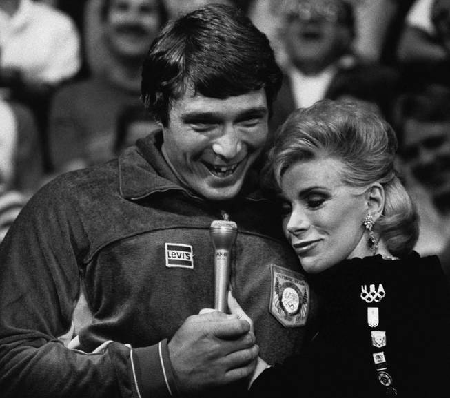 "Entertainer Joan Rivers embraces Greco-Roman wrestling gold medalist Jeff Blatnic during the taping of ""The Johnny Carson Show,"" at the NBC Studios in Burbank, Calif., Aug. 11, 1984. Blatnic was one of several members of the U.S. Olympic team that visited the show on Friday."