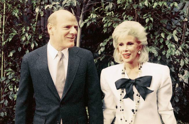 Comedian Joan Rivers and Barry Diller, chairman of Fox Inc., arrive for news conference in Los Angeles to announce that she will host a live talk show on Fox Broadcasting Co. that will compete with late night king Johnny Carson, May 6, 1986. Miss Rivers will lead the attack for Fox Broadcasting Corps new fourth network.