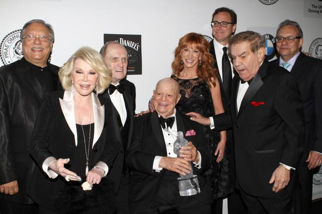 Musician Arturo Sandoval, left, Comedian Joan Rivers, Comedian Bob Newhart, Honoree Don RIckles, Comedian Kathy Griffin, Actor Bob Saget, Friars Clubs Dean Freddie Roman and Comedian Lewis Black pose for photos at the Friars Club Roast in his honor at the Waldorf Astoria on Monday, June 24, 2013 in New York.