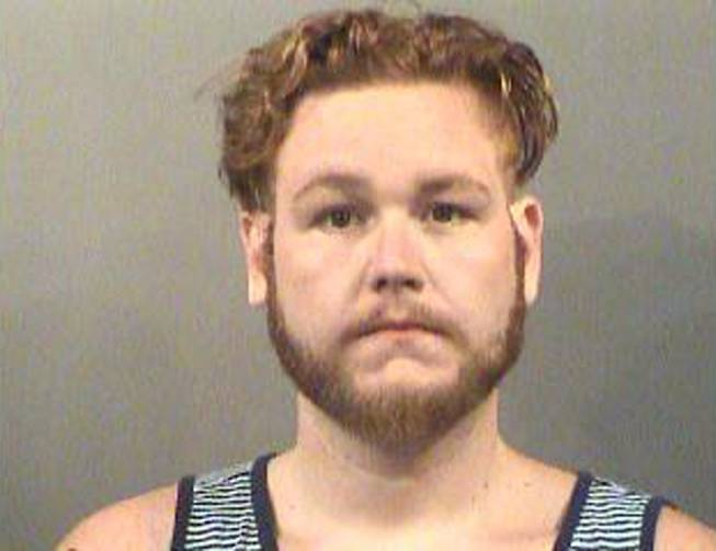 This image provided by the Sedgwick County Jail shows Seth Jackson, who has been charged with first-degree murder in the death of his 10-month-old foster daughter who he left in a hot car on July 24 in Wichita, Kansas.