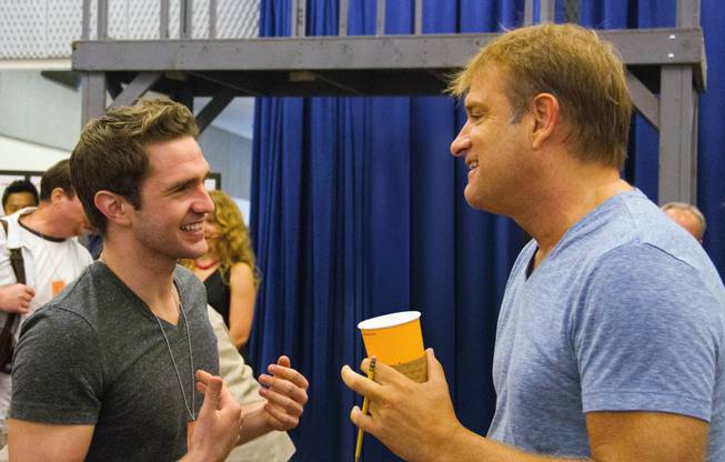 "This photo provided by Disney Theatrical Productions shows actor, Dan DeLuca, left, and director, Jeff Calhoun, during rehearsals for ""Newsies"" at New 42nd Street Studios on Wednesday, Sept. 3, 2014, in New York. The North American company of the Broadway hit ""Newsies"" is about to high-kick its way through a 25-city tour and its being led by the 22-year-old actor who'll make a triumphant homecoming in Pittsburgh in time for Thanksgiving."