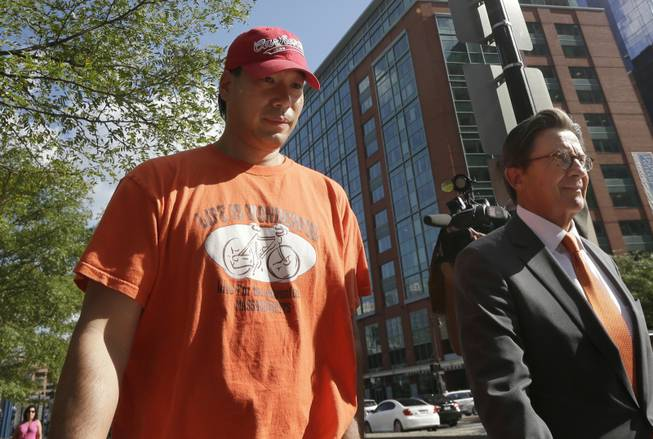 Glenn Adam Chin, left, a former supervisory pharmacist at the New England Compounding Center, walks with his attorney Paul Shaw, right, after appearing in federal court Thursday, Sept. 4, 2014, in Boston. The pharmacy, which custom-mixed medications in bulk, has been blamed for a 2012 outbreak of fungal meningitis that killed 64 people. Chin was charged with one count of mail fraud, but federal prosecutors said it is part of a larger criminal investigation of Chin and others.