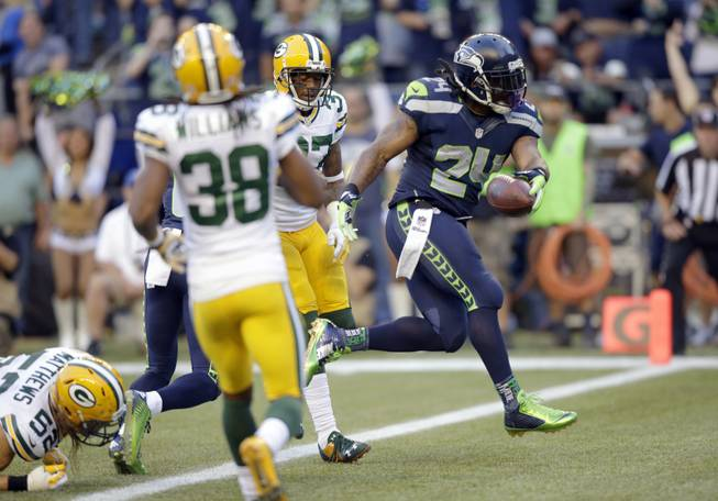 Seattle Seahawks running back Marshawn Lynch scores a touchdown in the first half against the Green Bay Packers on Thursday, Sept. 4, 2014, in Seattle.