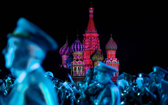 "AP10ThingsToSee- St. Basil Cathedral is lit using show lights as Serbian Nish military band members perform during the rehearsal of ""Spasskaya Tower"" International Military Orchestra Music Festival at the Red Square in Moscow, Russia, Friday, Aug. 29, 2014."