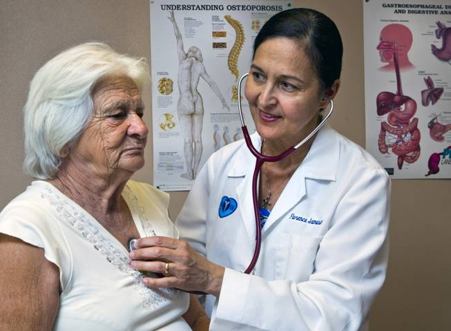 (From right) Dr. Florence Jameson, a veteran OB/GYN in town, checks on patient Maria Sosa-Cuellar at the Volunteers in Medicine on Wednesday, September 3, 2014.  Jameson is is also the volunteer CEO there which opened its first clinic a few years ago to serve uninsured patients.