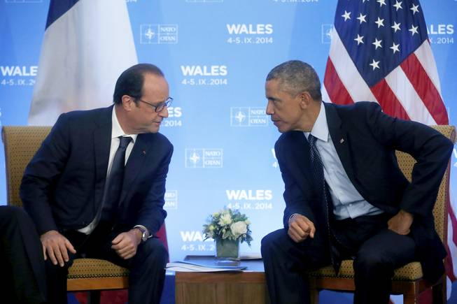 U.S. President Barack Obama meets with France's President Francois Hollande at the NATO summit at the Celtic Manor, Newport, Wales, Friday, Sept. 5, 2014.