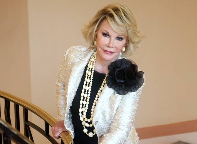"This Oct. 5, 2009, file photo shows Joan Rivers as she presents ""Comedy Roast With Joan Rivers "" during the 25th MIPCOM (International Film and Programme Market for TV, Video, Cable and Satellite) in Cannes, France. Rivers died Thursday, Sept. 4, 2014. She was 81. Rivers was hospitalized Aug. 28 after going into cardiac arrest at a doctor's office."