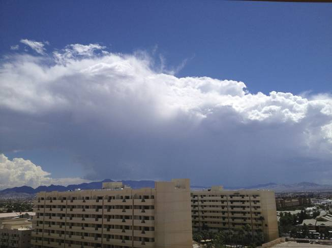 Storm clouds rise above the southern Las Vegas Valley on Sunday, Sept. 7, 2014. The building in the foreground is the Cancun Resort, 8335 Las Vegas Blvd. South.