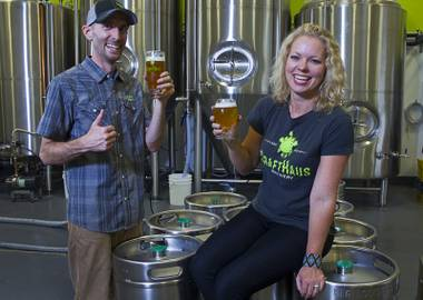 Founders Dave and Wyndee Forrest pose by kegs of beer at the CraftHaus Brewery in the Henderson Booze District, 7350 Eastgate Rd., Monday, Sept. 8, 2014. The brewery celebrates it's grand opening Friday, Sept. 12.