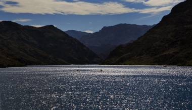 Boats cruise along the glimmering Colorado River later in the day on Saturday, August 30, 2014.