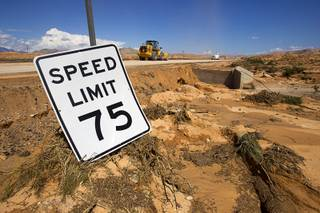 A speed limit sign is shown by the side of Interstate 15 near Moapa Tuesday, Sept. 9, 2014. About 1 mile of freeway was severely damaged by runoff from Monday's storm. The Nevada Department of Transportation expects to have two lanes open by the weekend, a spokesman said.