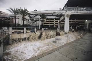 A flash flood rages through the LINQ parking garage and surrounding areas in Las Vegas, Nev. on Monday, Sept. 8, 2014.