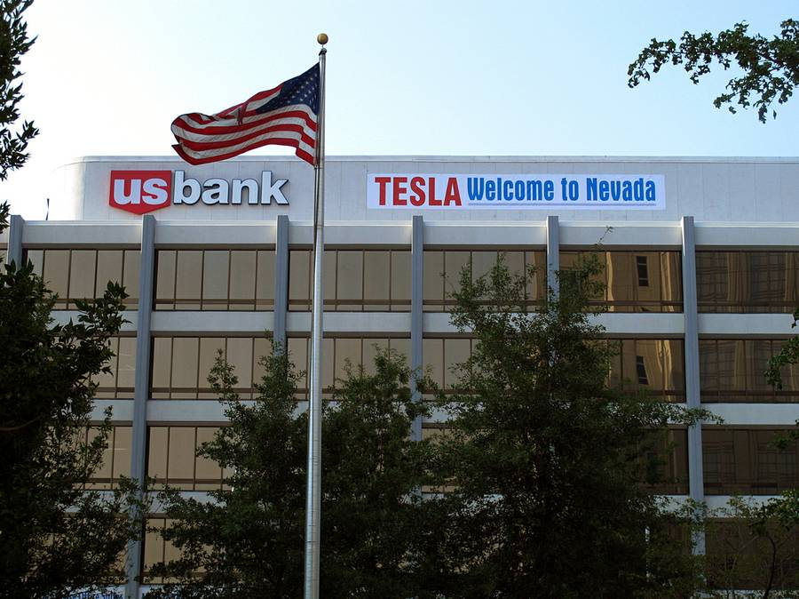 "A banner welcoming Tesla to Nevada is hung on the US Bank building south of the downtown Reno casino district Tuesday, Sept. 9, 2014. State lawmakers planned to meet in a special legislative session in Carson City on Wednesday to consider a package of tax breaks and incentives worth as much as $1.3 billion to seal a deal to bring the electric car maker's $5 billion lithium battery ""gigafactory'' to an industrial park in the state."