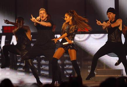 Ariana Grande performs with dancers during the 2014 iHeartRadio Music Festival at MGM Grand Garden Arena on Friday, Sept. 19, 2014, in Las Vegas.