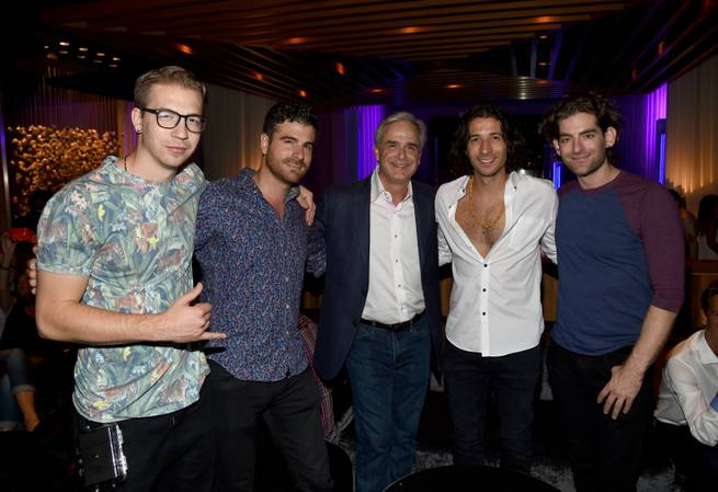 Mandalay Bay President and COO Chuck Bowling is flanked by Magic! members drummer Alex Tanas, guitarist Mark Pellizzer, singer Nasri Atweh and bassist Ben Spivak at the Delano Las Vegas grand opening Thursday, Sept. 18, 2014, on the Strip.