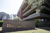 San Diego's dominant newspaper has laid off nearly a third of its 600 employees after it was acquired by Los Angeles Times owner Tribune Publishing ...