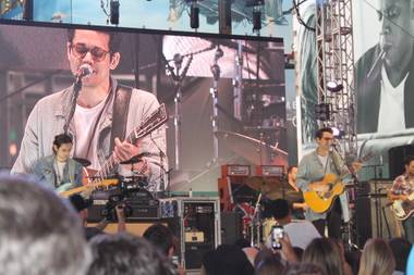 John Mayer performs a three-song set as part of the announcement Rock In Rio lineup announcement in Times Square on Friday, Sept. 26, 2014.