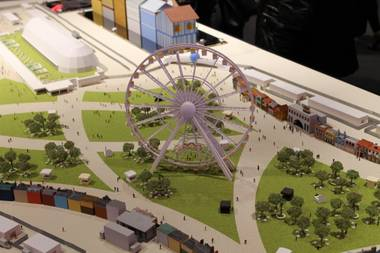 A look at a rendering of the Ferris wheel planned for the 2015 Rock in Rio music festival, which will also build a zipline on the site, and offer several retail, concession and merchandize booths along with a VIP center.