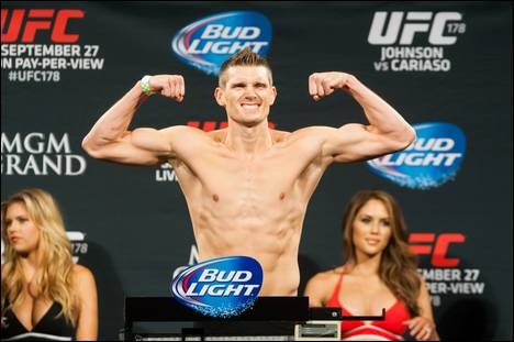 Stephen Thompson flexes after weighing in for UFC 178 Friday, September 26, 2014, at the MGM Grand's Convention Center.