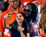Snoop Dogg takes time to have a picture taken with a Bishop Gorman fan in the stands during the game versus St. John Bosco on Friday, September 26, 2014.