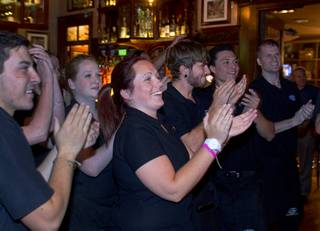 Employees applaud during a kick-off for a Guinness World Record attempt in the Ri Ra Irish Pub at Mandalay Place Wednesday, Oct. 1, 2014. The pub is attempting to break the Guinness World Record for longest music marathon performed by Irish bands. The current record is 15 days.