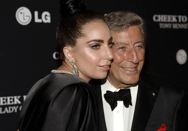 "In this July 28, 2014, photo, Lady Gaga and Tony Bennett attend their concert taping in New York. Bennett and Gaga's jazz collaborative album, ""Cheek to Cheek,"" was released Sept. 23, 2014."