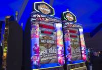 Harley Davidson-themed slot machines are displayed at the IGT booth during the Global Gaming Expo (G2E) at the Sands Expo Center Thursday, Oct. 2, 2014.