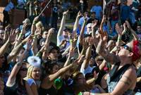 Las Vegas Hempfest attendees cheer for cannabis-related merchandise being thrown from the Top Shelf Stage 1 at the Clark County Amphitheater on Saturday, October 4, 2014.