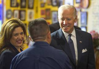 Vice President Joe Biden meets with business owner Louisa Mendoza, left, and restaurant owner Javier Barajas before a round-table discussion on raising the minimum wage at Casa Don Juan restaurant Monday, Oct. 6, 2014.