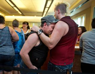 Morgan Floyd is consoled by David Parry as same-sex couples wait for hours hoping to get licenses from the Marriage Bureau only to leave disappointed on Wednesday, October 8, 2014. .