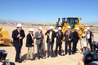 Investors and lawmakers line up at a ceremonial groundbreaking of health care project Union Village on Wednesday, Oct. 8, 2014, at the project site on Galleria Drive at U.S. 95 in Henderson.
