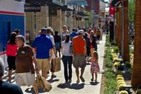 Shoppers make their way along walkways Thursday, Oct. 9, 2014, during the grand opening of Downtown Summerlin.